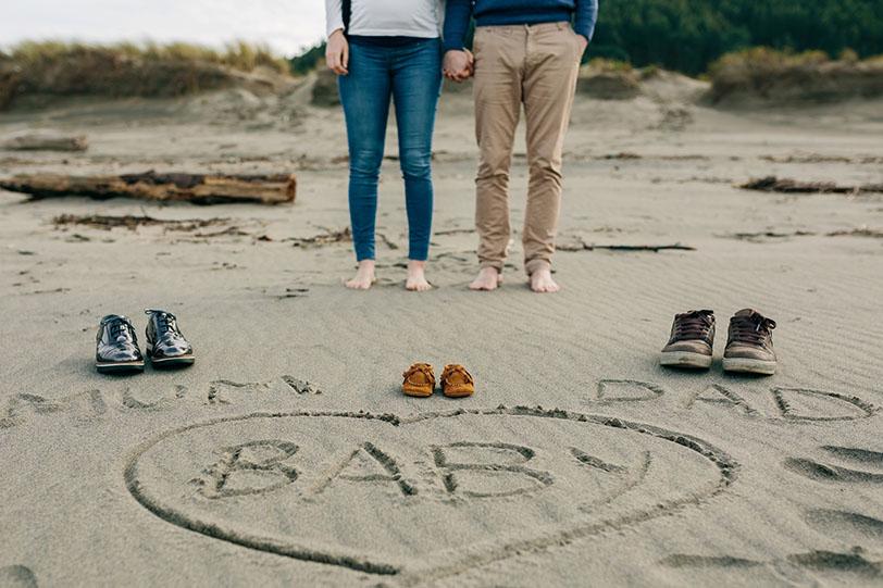 Cute Pregnancy Announcement on Sand
