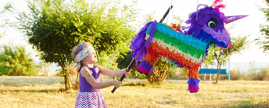 Child Using Creative Gender Reveal Piñata