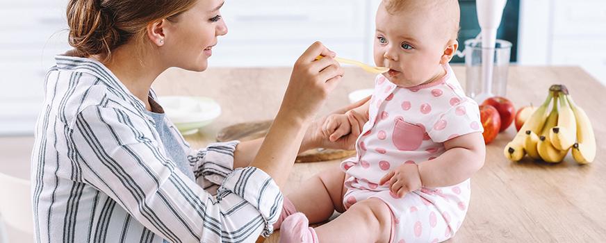 New Mom Feeding Baby Homemade Baby Food