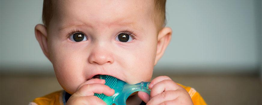 Toddler Using Teething Ring